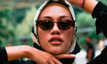 Woman in hijab wearing sunglasses