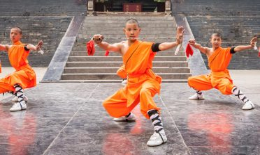 Young monks perform